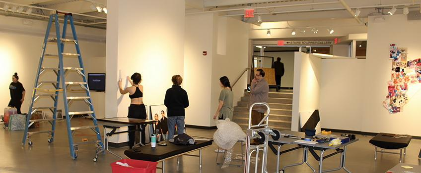 Students setting up the art gallery