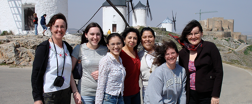 students in front of windmills