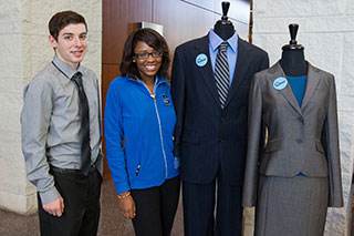 students standing beside suits