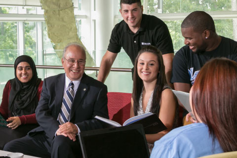 Harvey Kesselman with students