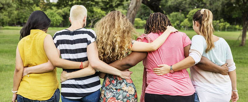Group of females supporting each other in an embrace