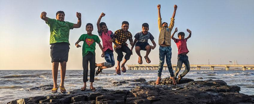 kids jumping on jetty