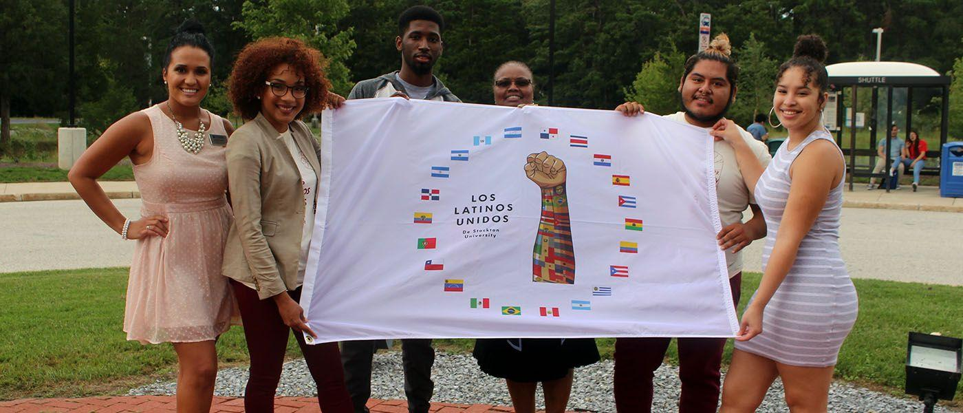Students raise Pan-American flag
