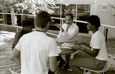 Harvey Kesselman conversing with students outdoors