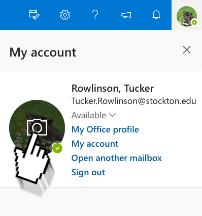 "A screenshot of Outlook Web in the ""my account"" menu, an arrow is pointing towards the button to change a profile picture."