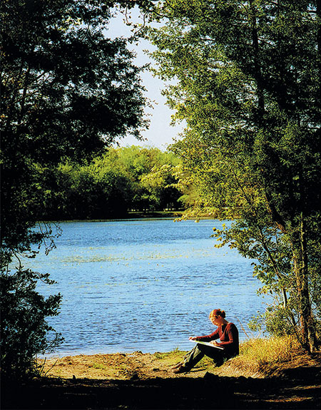Student sketching by Lake Fred