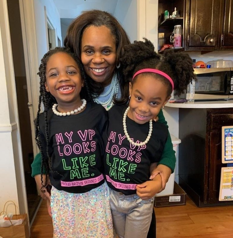 Associate Professor of Social Work Dr. Maya Lewis poses with her twin girls on Inauguration Day as they watch Kamala Harris sworn in as the first woman Vice President of the United States