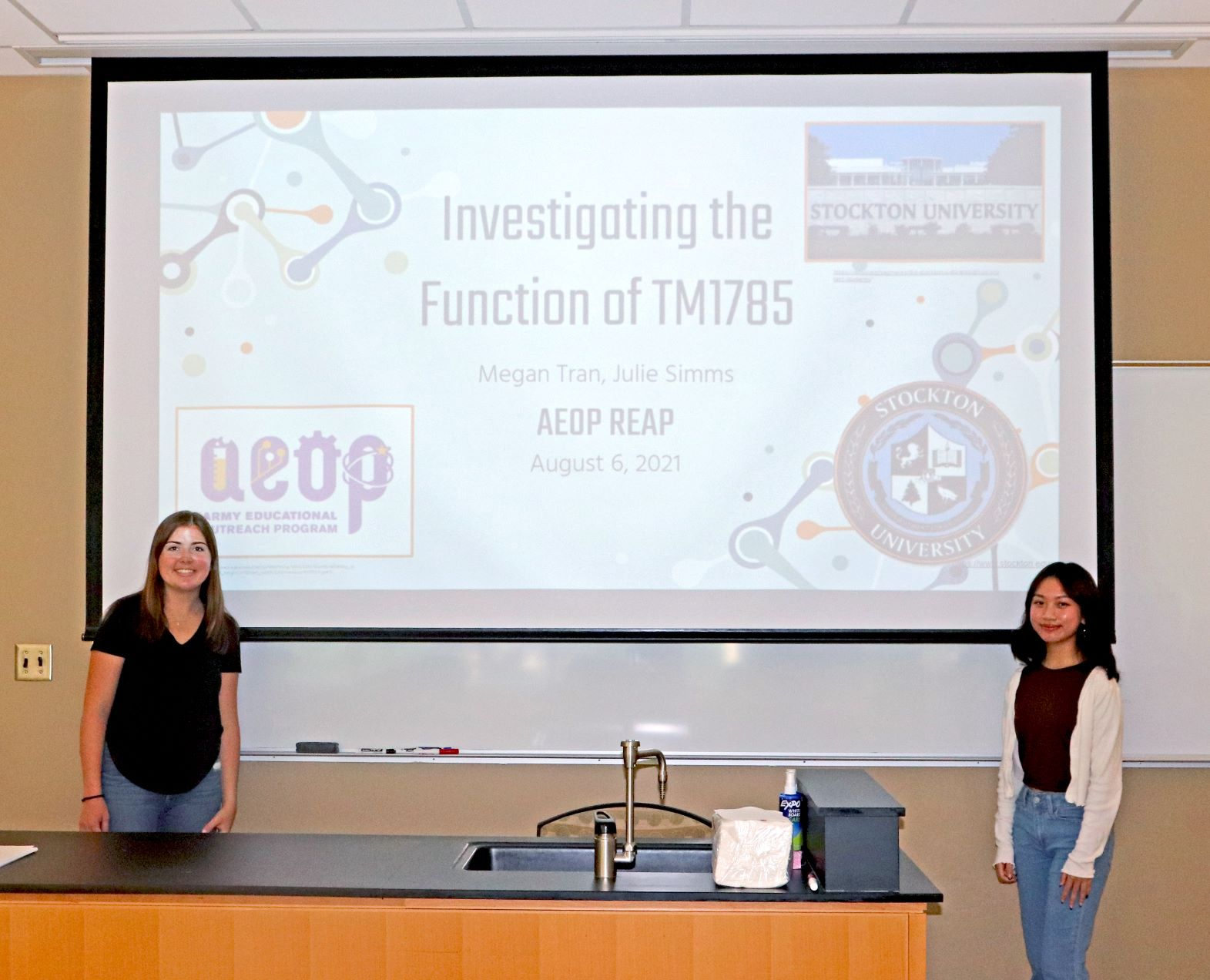 Julie Simms and Megan Tran present their STEM research at the Research and Engineering Apprenticeship (REAP) Symposium at Stockton University.