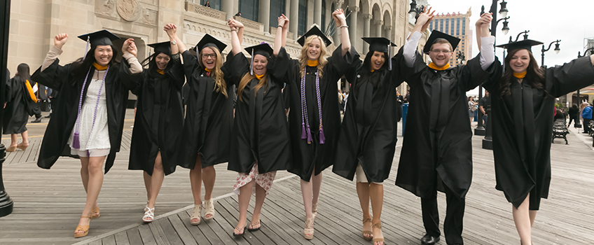 graduates on the AC Boardwalk