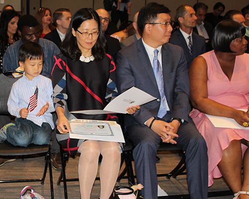New Citizens Take Oath at Naturalization Ceremony - News