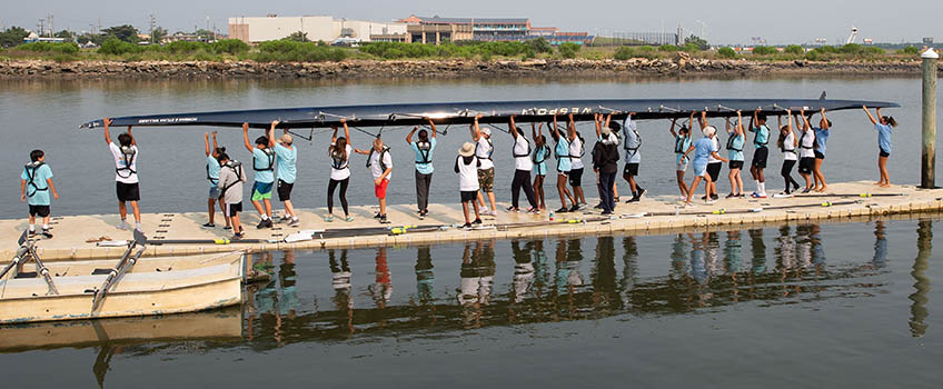 youth rowing carrying