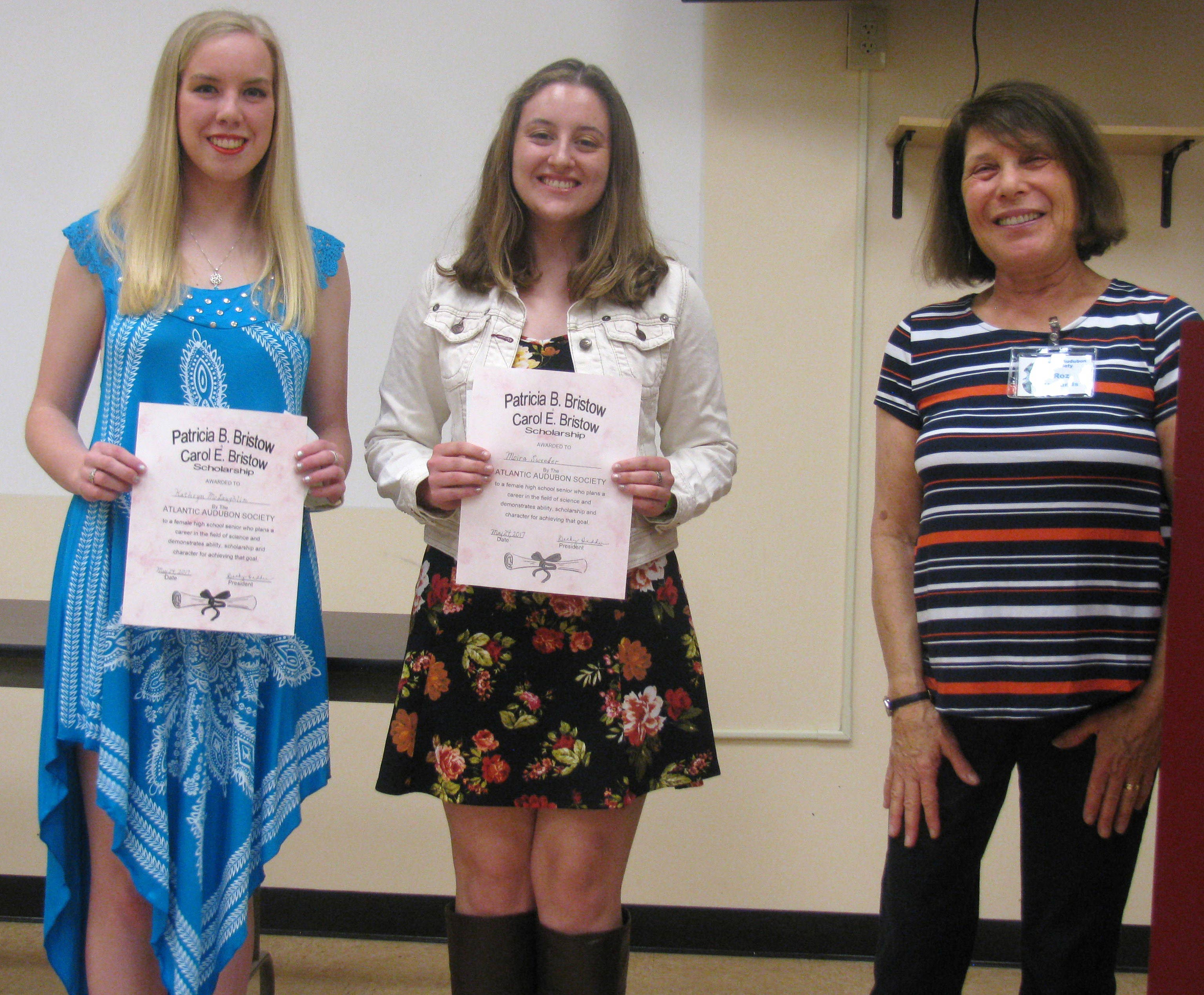 Kathryn McLaughlin and Moira Sweeder receive the Patricia and Carol Bristow Memorial Scholarship from AAS member Roz Herlands. Photo credit: Charles Herlands