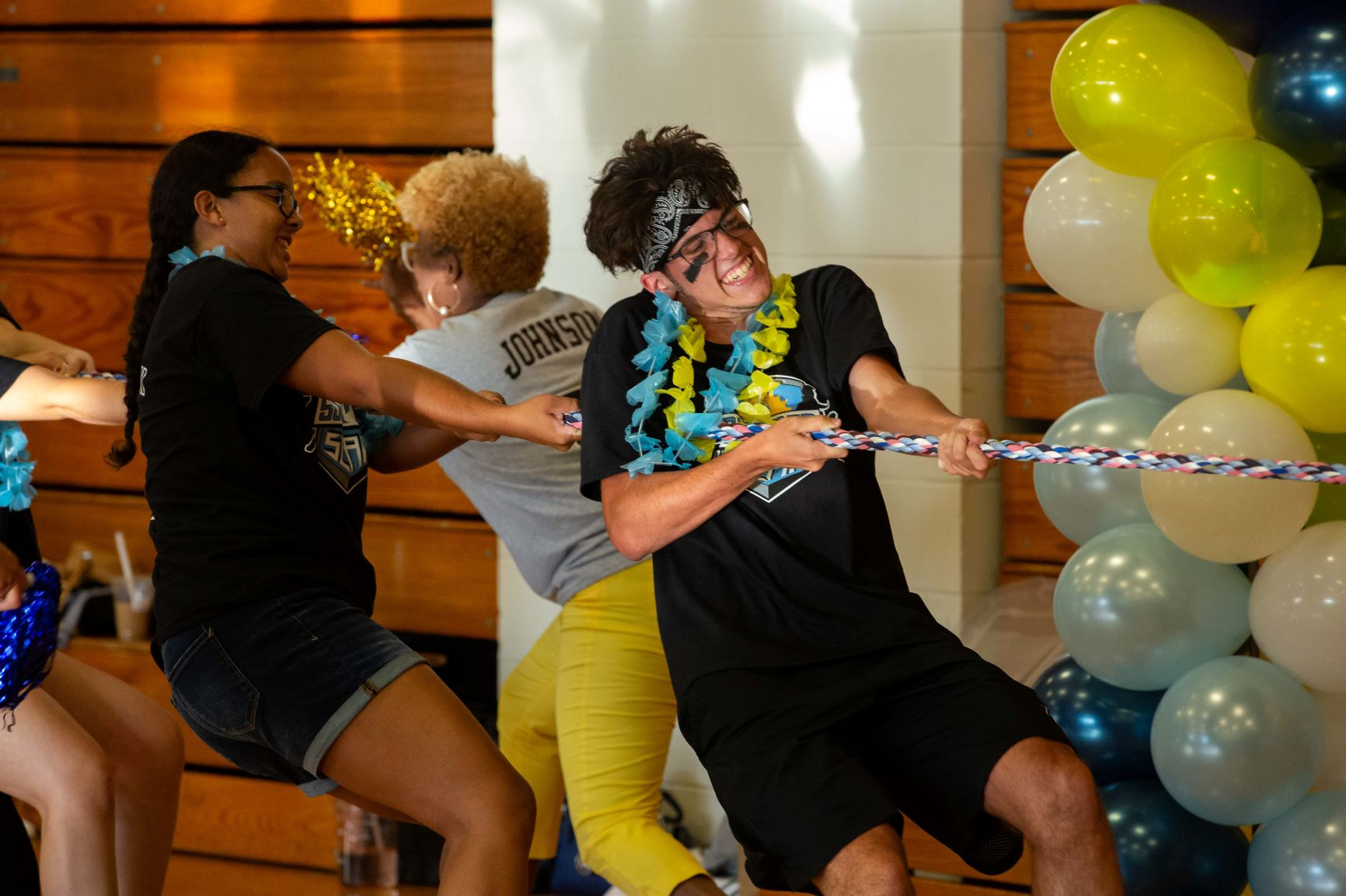 New students compete in tug of war at the Summer Slam event during Stockton University's overnight orientation experience called Nest Fest.