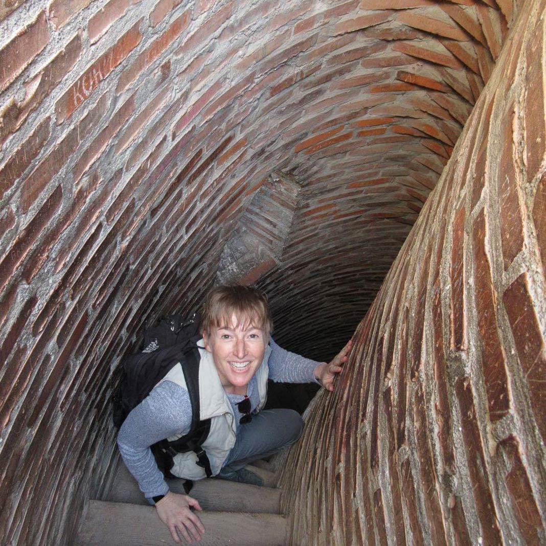 Kristin Jacobson sitting in spiral stairwell