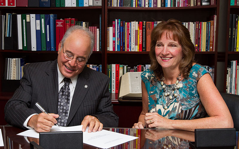 Harvey and Lynne Kesselman signing scholarship agreement