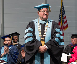 Harvey Kesselman wearing the Presidential Medallion at Commencement