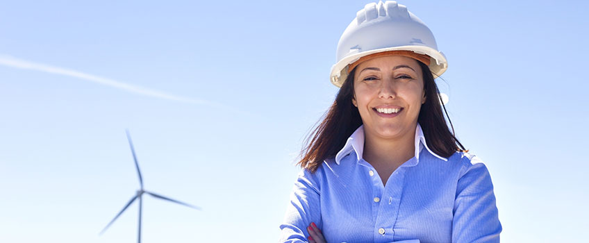 Image of woman in wind turbine farm