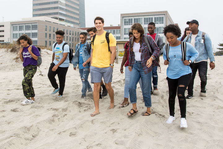 Students on beach outside Stockton Atlantic City