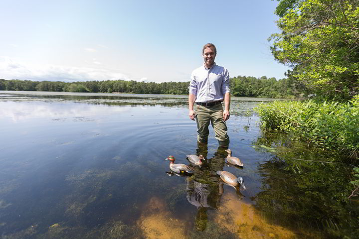 Cooper Rossner '18 takes his hand-carved decoys for a swim in Lake Fred.